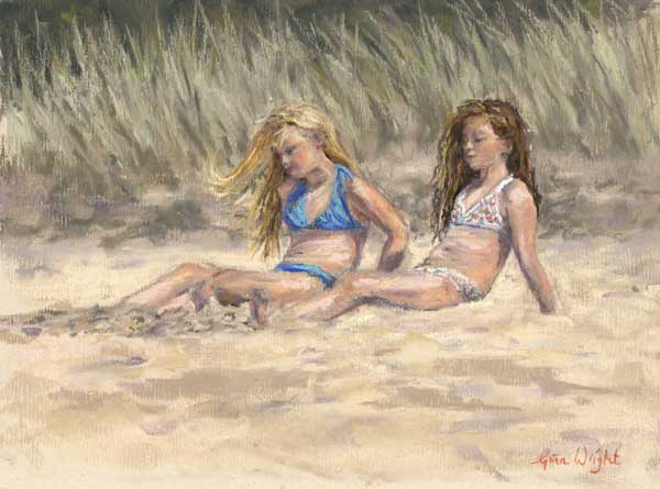 Two girls lazing on the beach