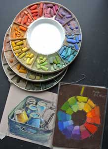 Pastels laid out in the colour wheel