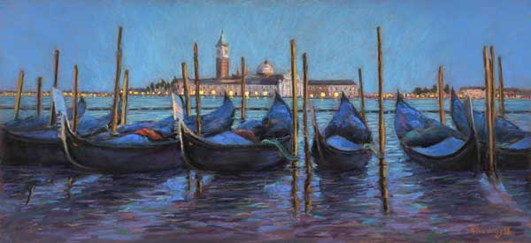 Gondolas moored and covered at night