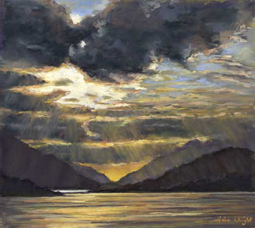 The sun setting over the loch of Glencoe surrounded by mountains